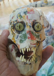 skull lightly built up with fangs and eyes